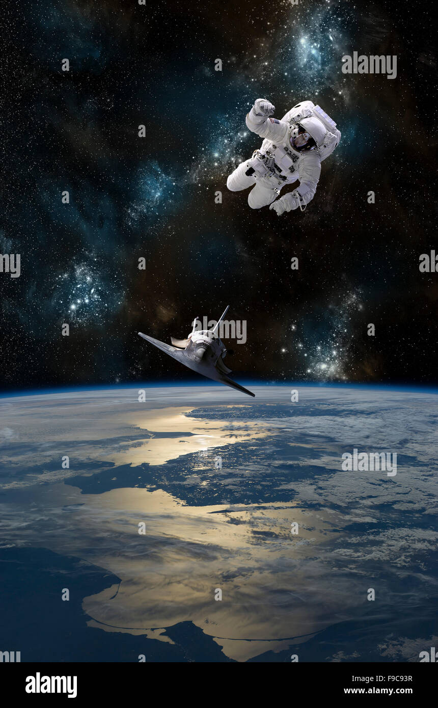 An astronaut drifting in space is rescued by a space shuttle orbiting Earth. Stock Photo