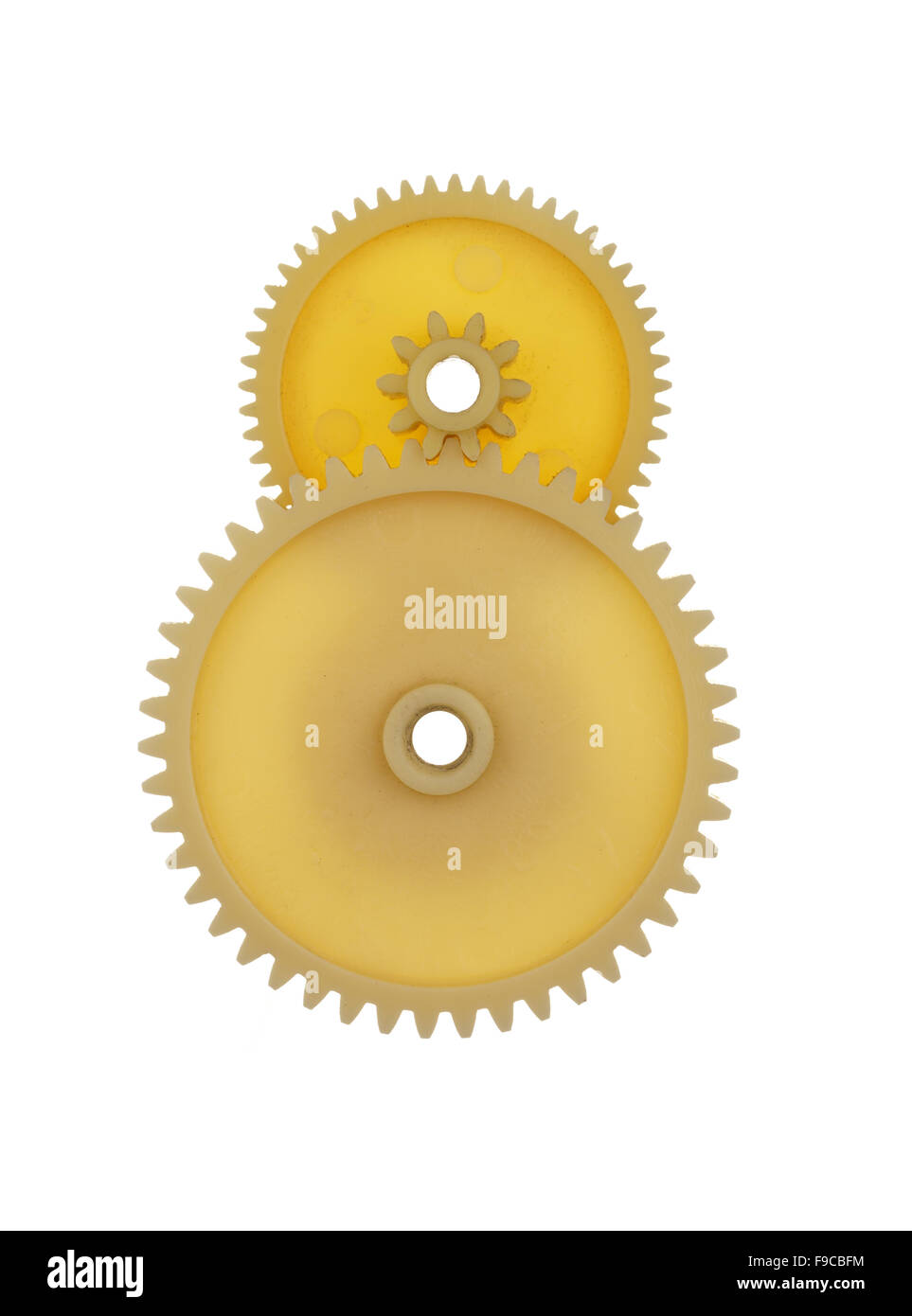 two plastic gears yellow isolated on a white background. - Stock Image