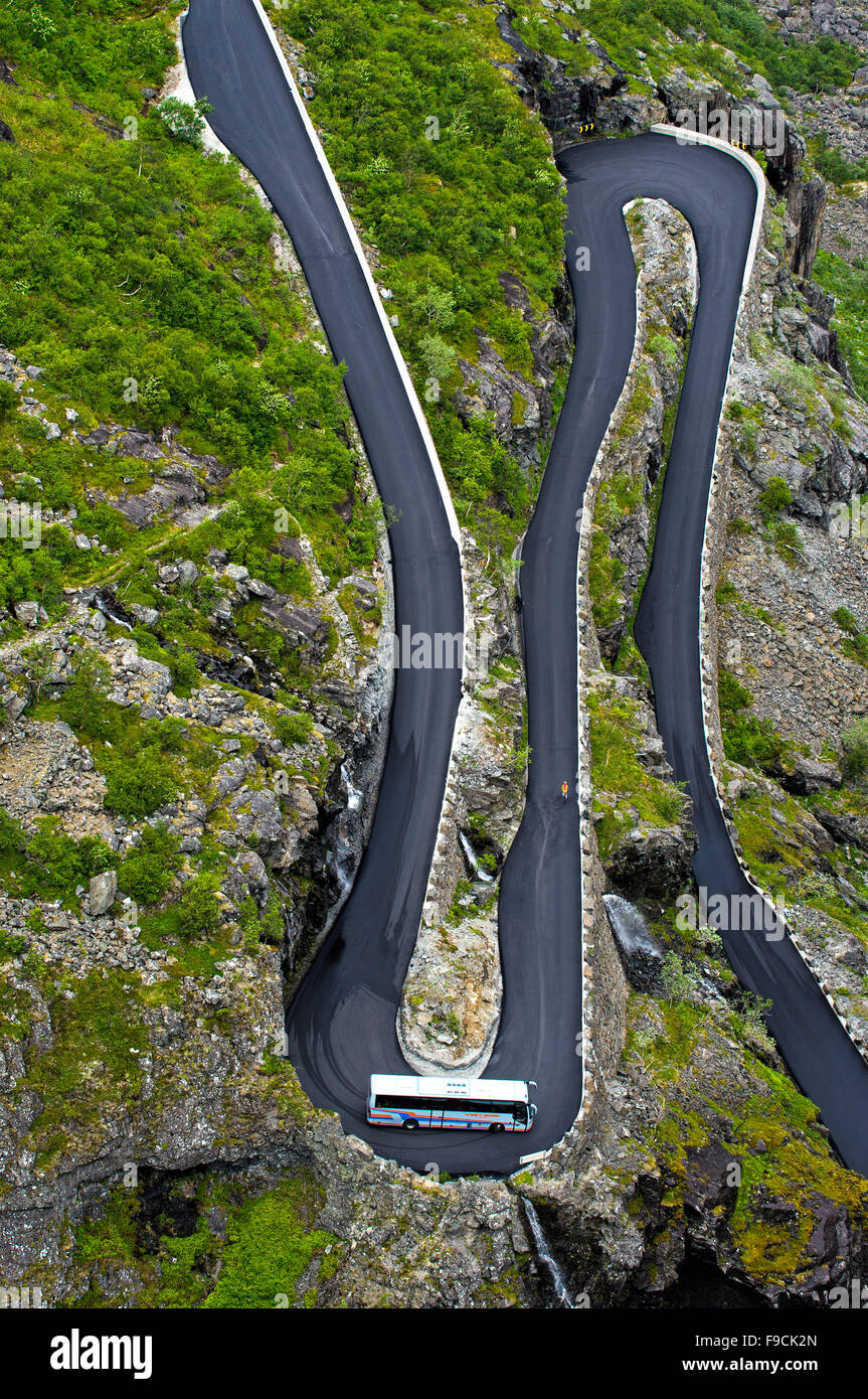 Coach in a narrow hairpin bend of the Trollstigen mountain road near Andalsnes, Møre og Romsdal county, Norway - Stock Image