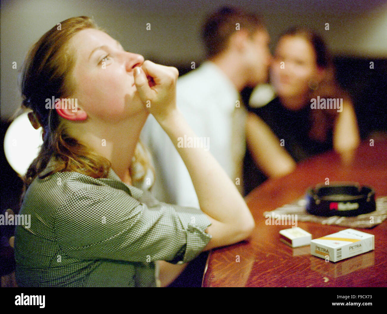Young Lonely Woman at The Bar Desk Stock Photo