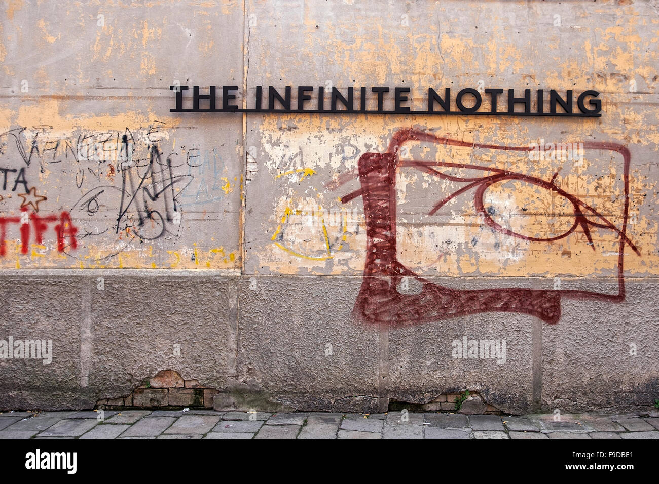 The Infinite Nothing, sign and graffiti on wall during the 2015 56th Venice Biennale.La Biennale di Venezia,Venice,Italy - Stock Image
