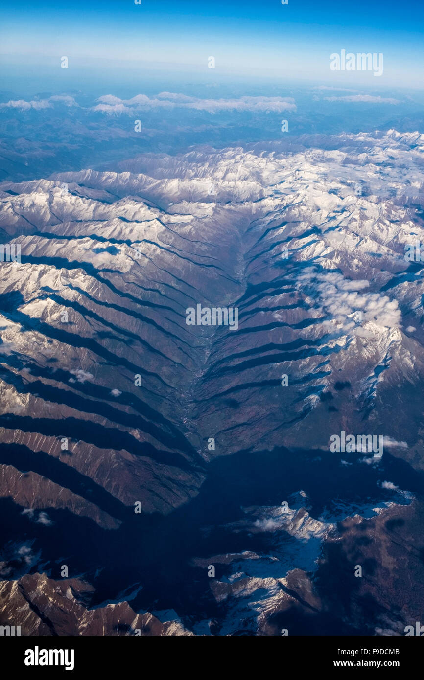 Aerial View of snow clad Swiss Alps from plane - Stock Image