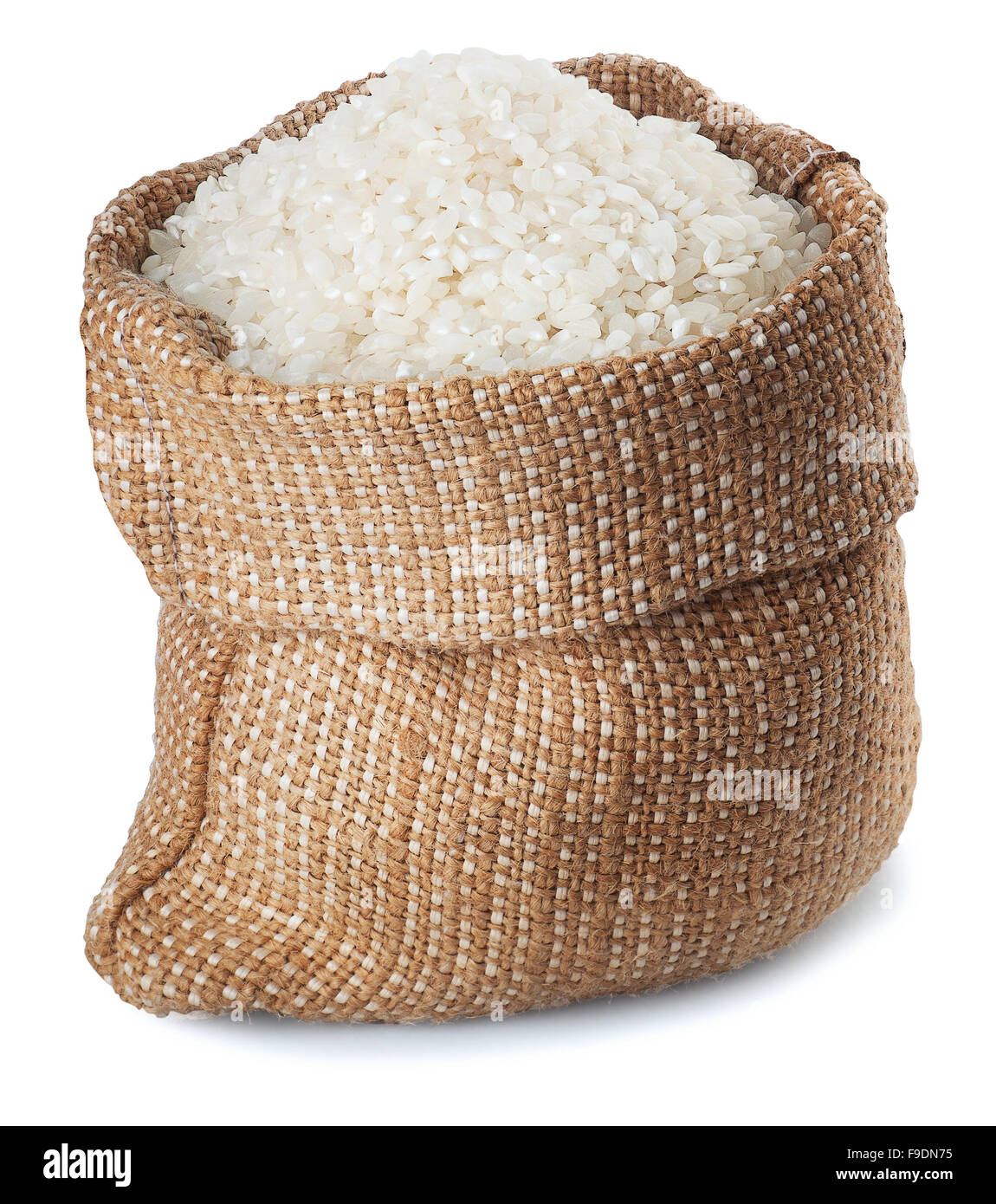 White rice in burlap sack isolated on white background - Stock Image