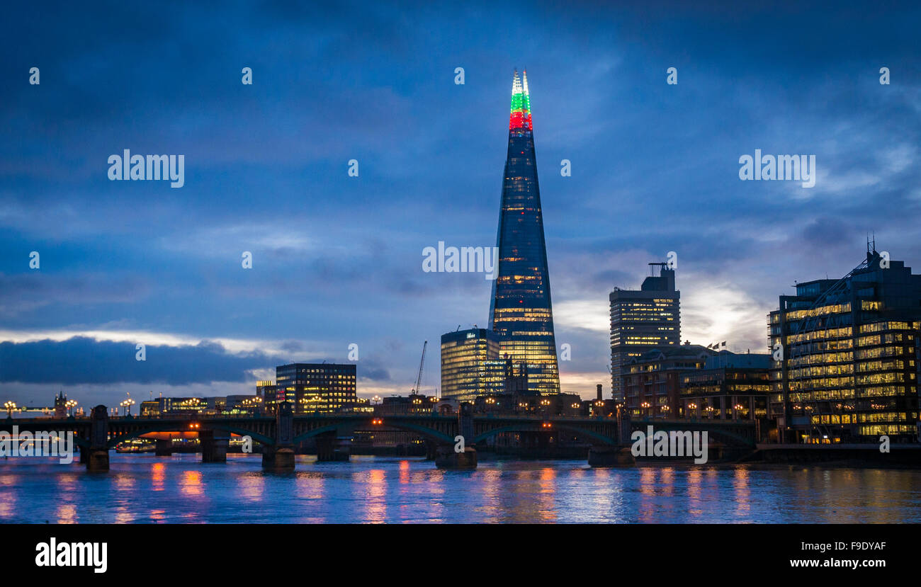 The Shard Building light's up for the Christmas season with alternating Green, Red and White lights at the top, - Stock Image