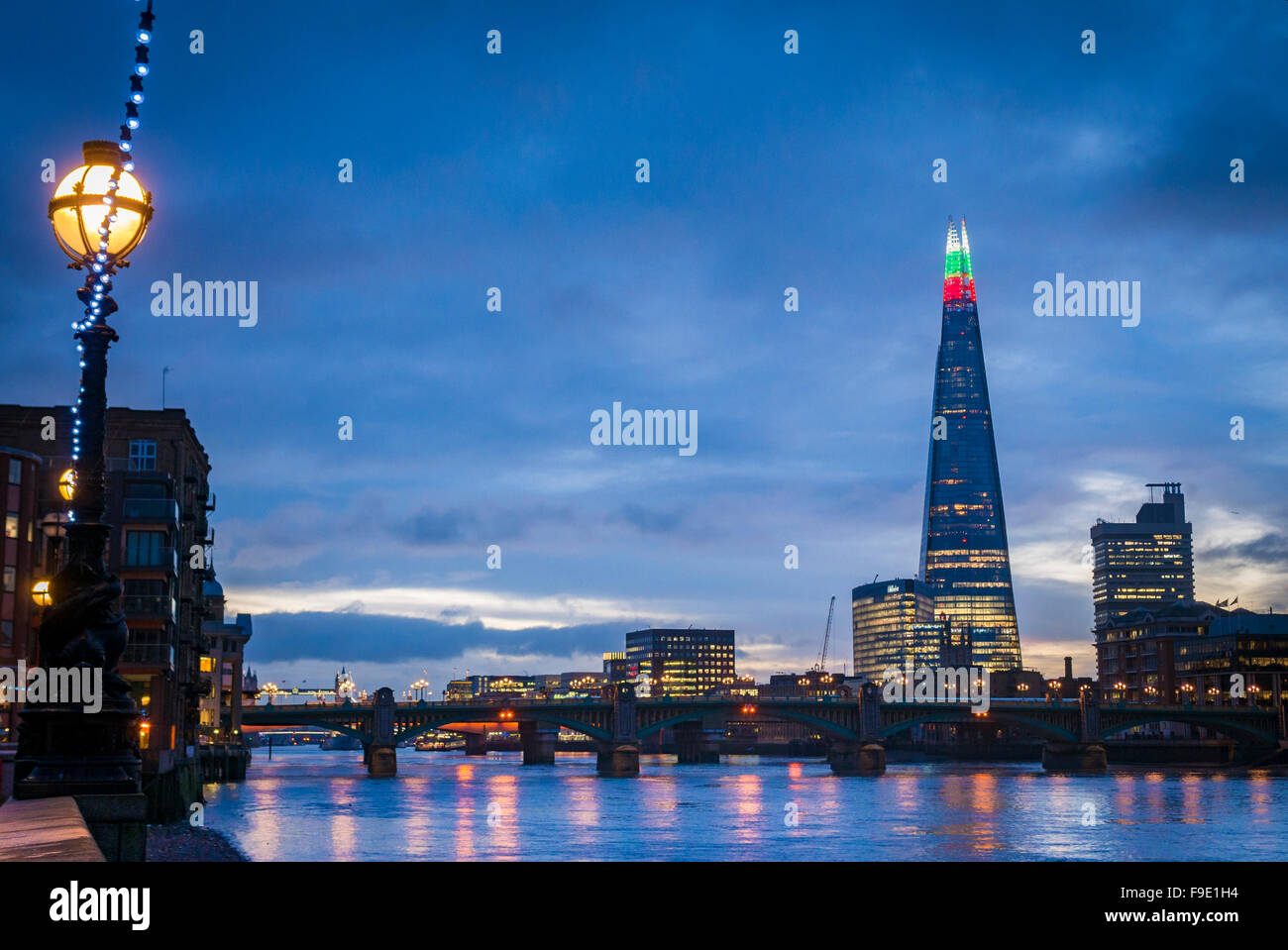The Shard Building  light's up for Christmas with alternating Green, Red and White at the top - Stock Image
