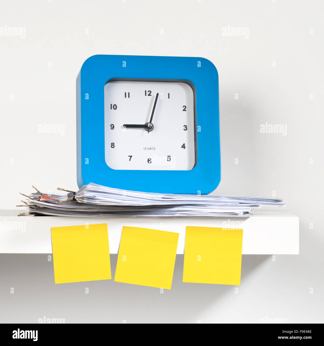 Many sticky notes stuck on the clock. Stock Photo