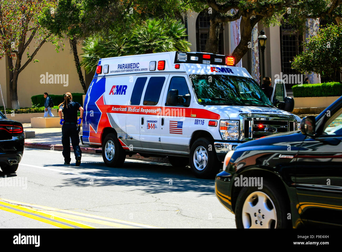 EMT vehicle at the roadside attending a call out in downtown Santa Barbara, California - Stock Image