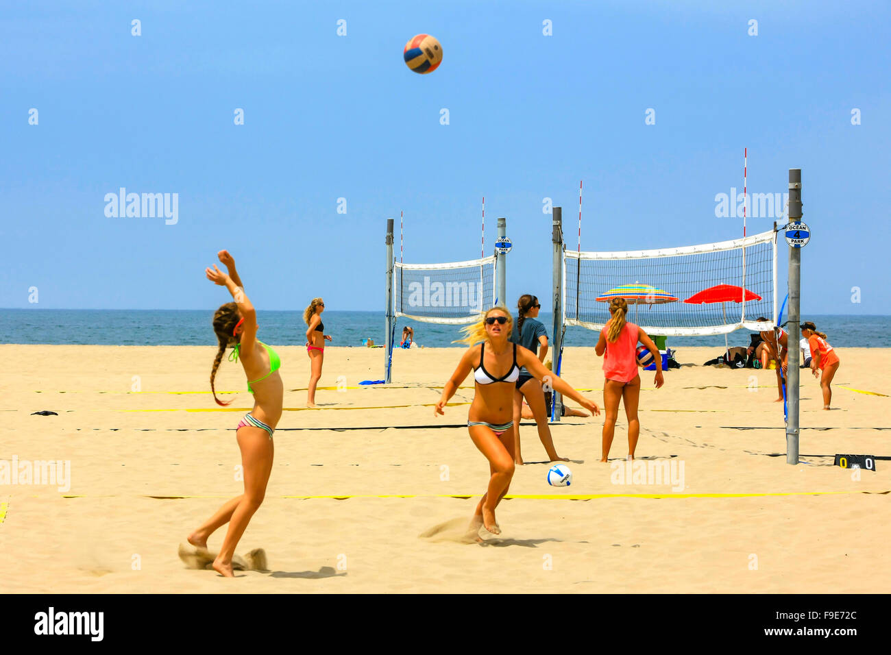 Young college girls playing beach volleyball on Santa Monica beach in California Stock Photo