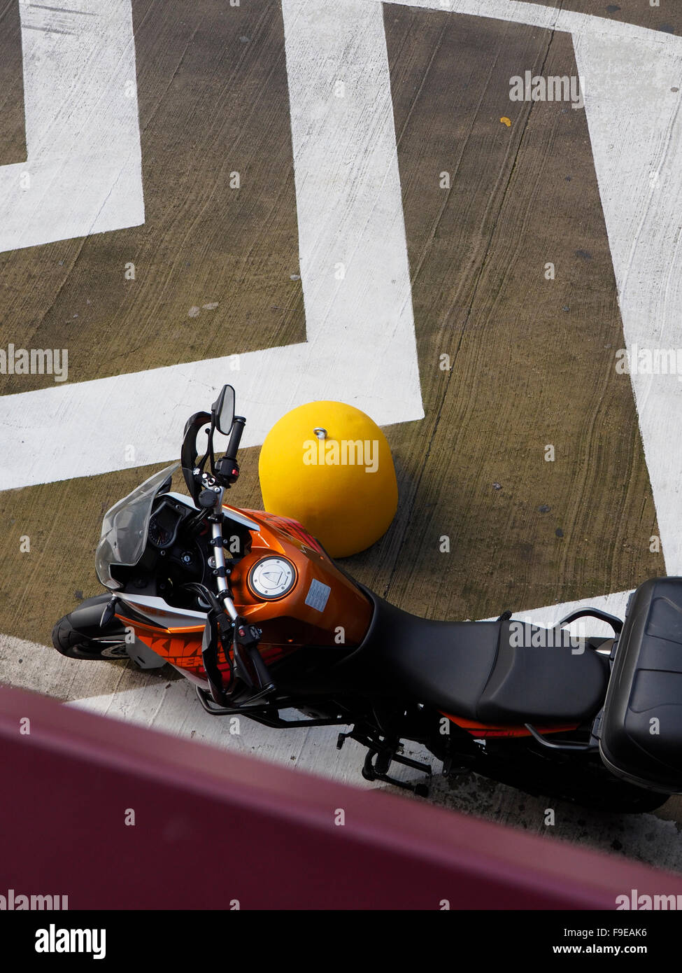 KTM adventure touring motorcycle parked seen from above in Rome EUR, Italy - Stock Image