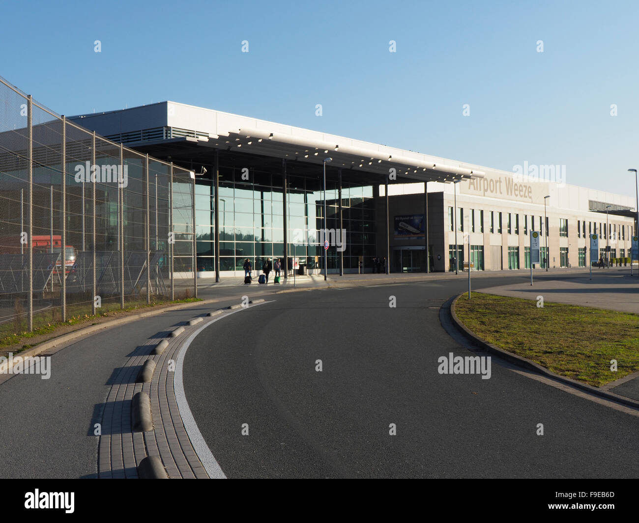 Weeze Niederrhein airport terminal exterior with a few travelers people NRN - Stock Image