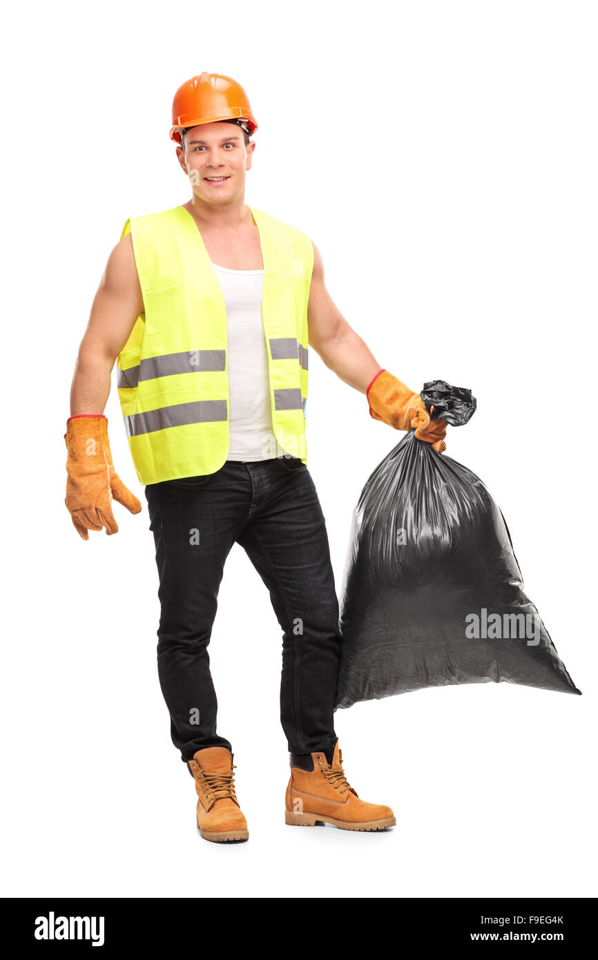 Full length portrait of a young male waste collector holding a garbage bag and looking at the camera - Stock Image