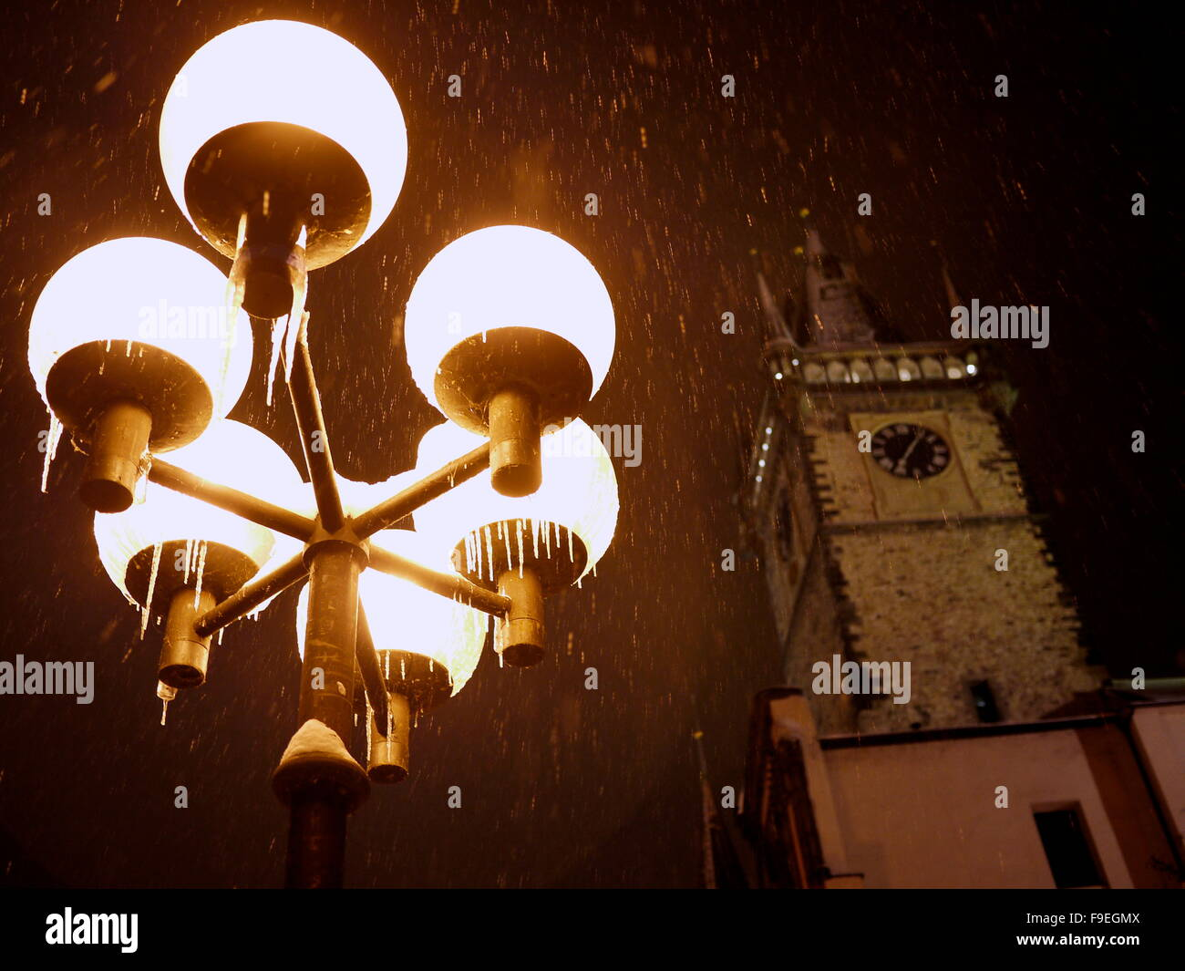 Detail of Streetlight and Tower in Background - Stock Image