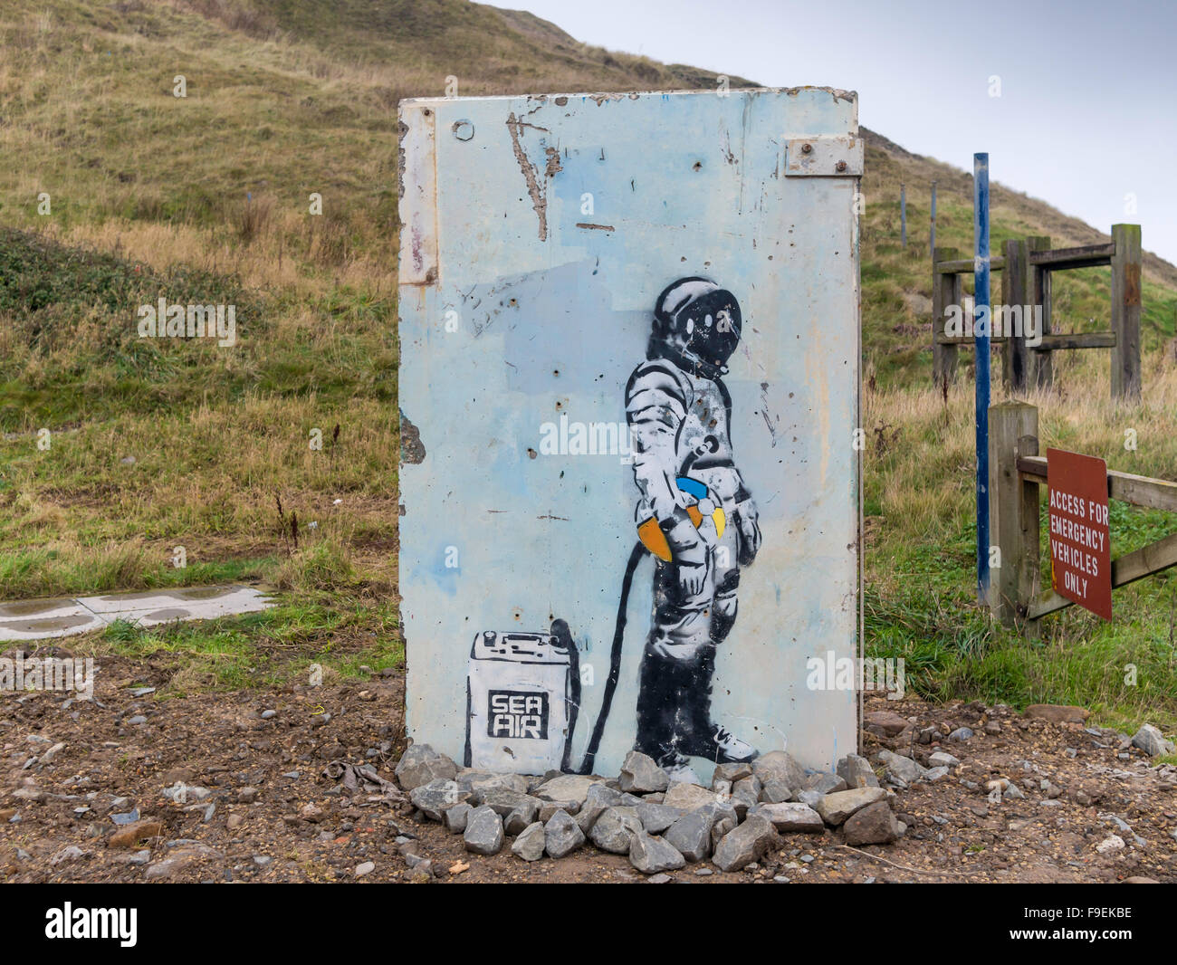 Graffito of a diver with a tank of sea air removed from a harbour wall during refurbishment re-erected as a piece Stock Photo