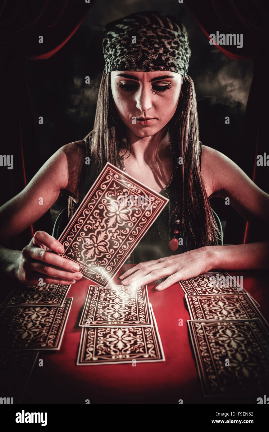 Composite image of fortune teller using tarot cards - Stock Image