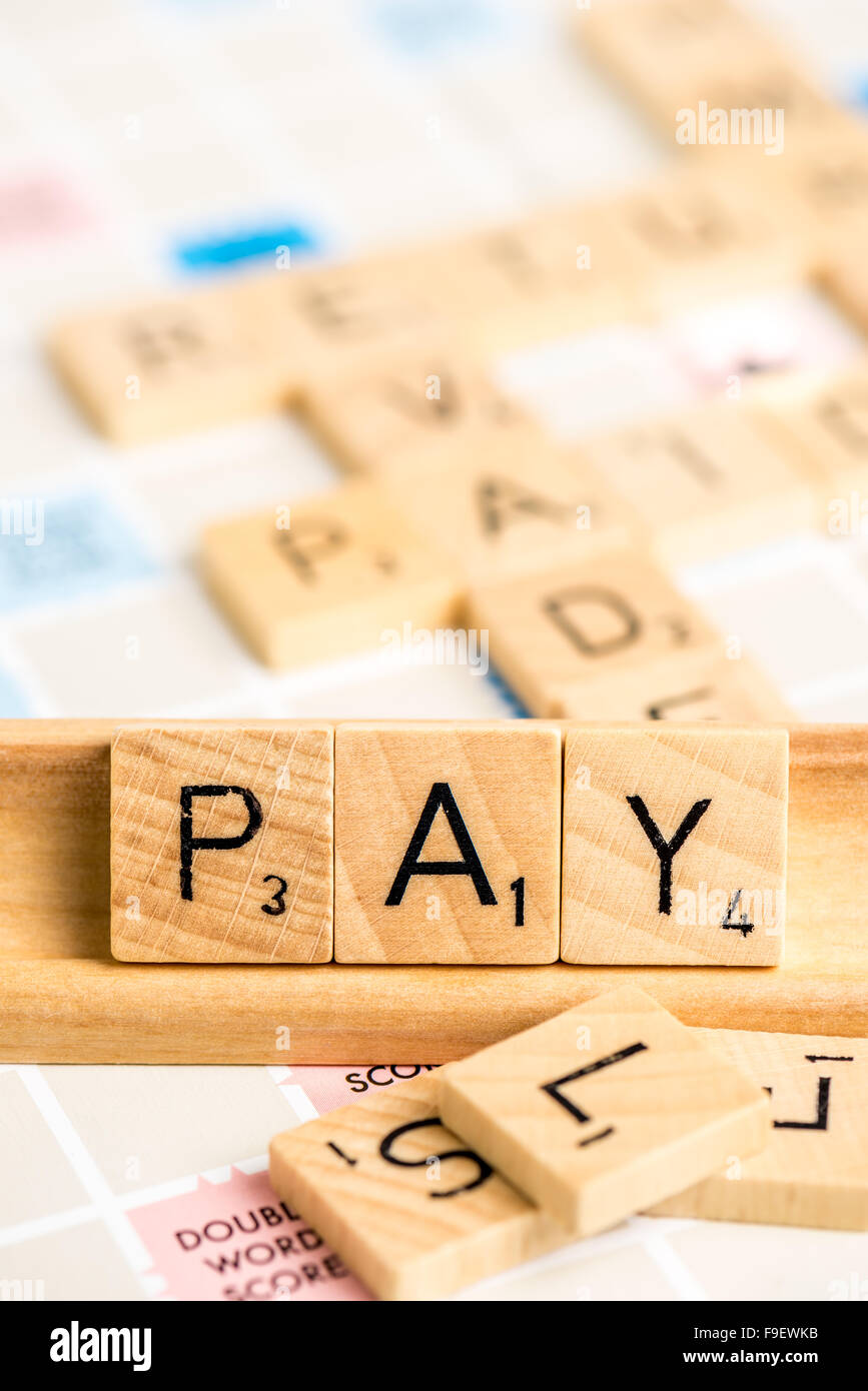 Scrabble - PAY. - Stock Image