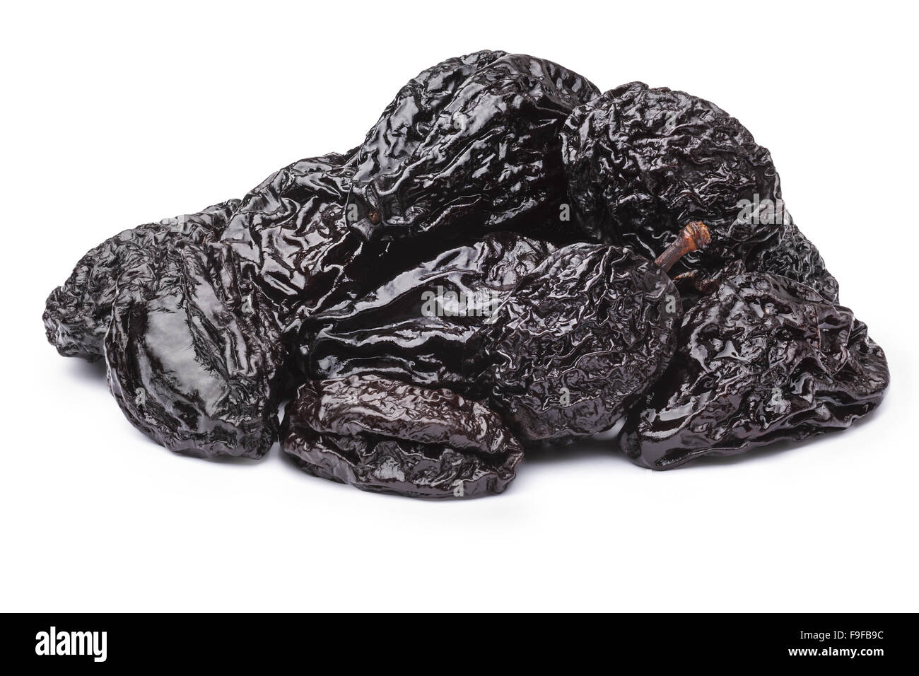 Prunes or dried plums. Infinite depth of field, spotless retouched. Clipping paths for both prunes and shadow Stock Photo