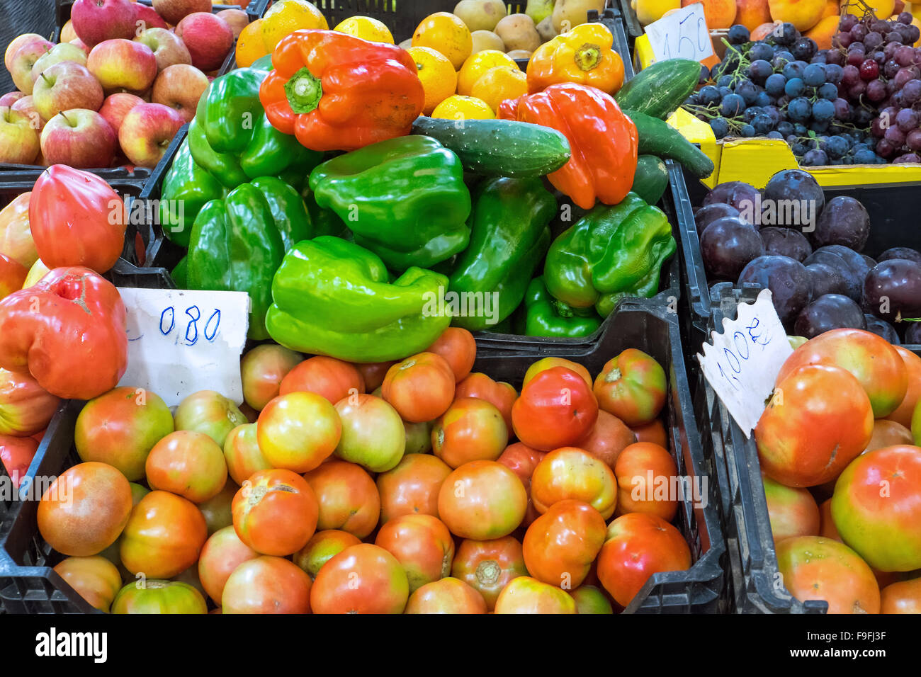 Different kinds of vegetables and fruits seen on a market - Stock Image