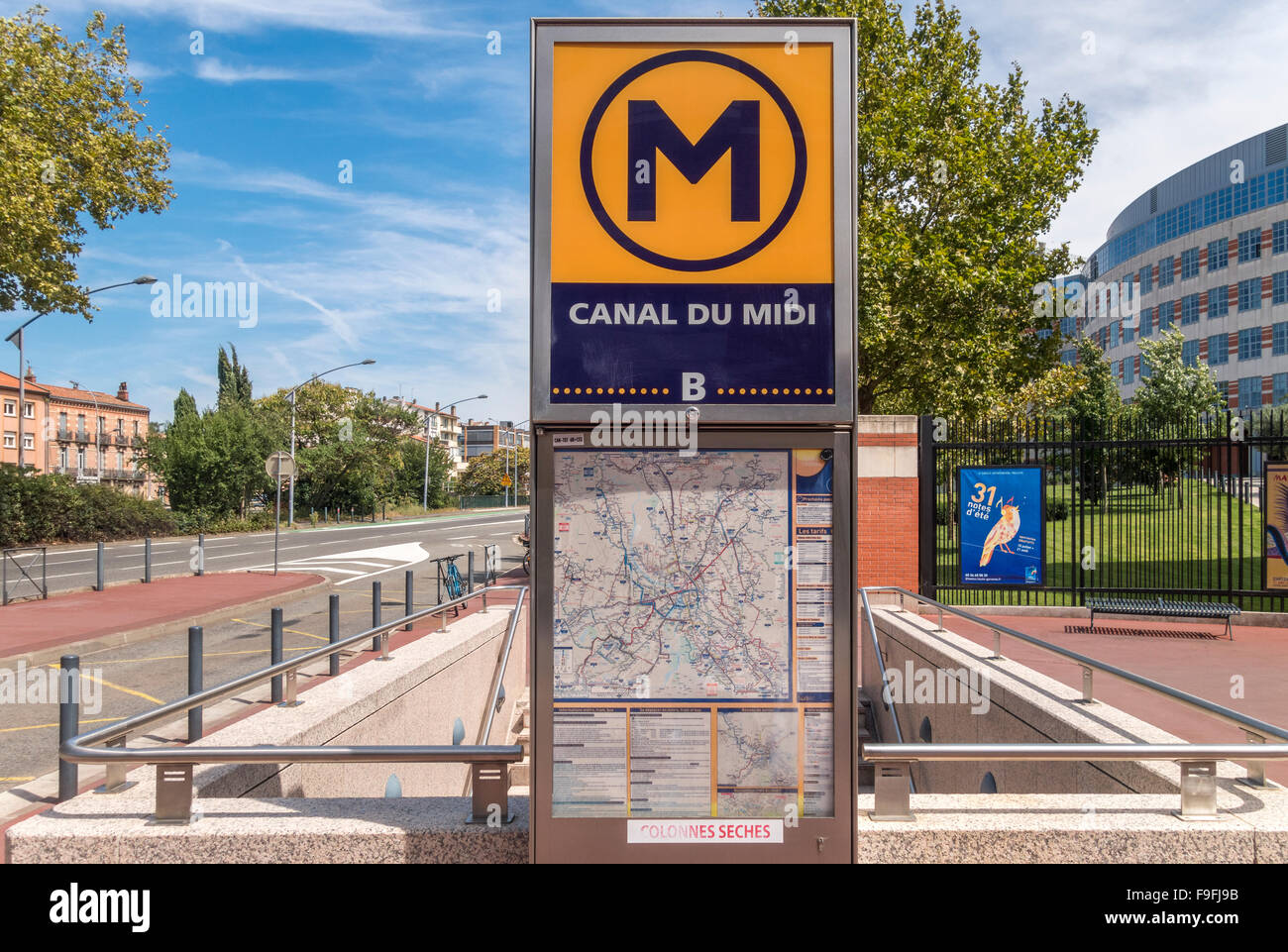 Toulouse Metro sign at the entrance to Metro Station Canal du Midi. - Stock Image