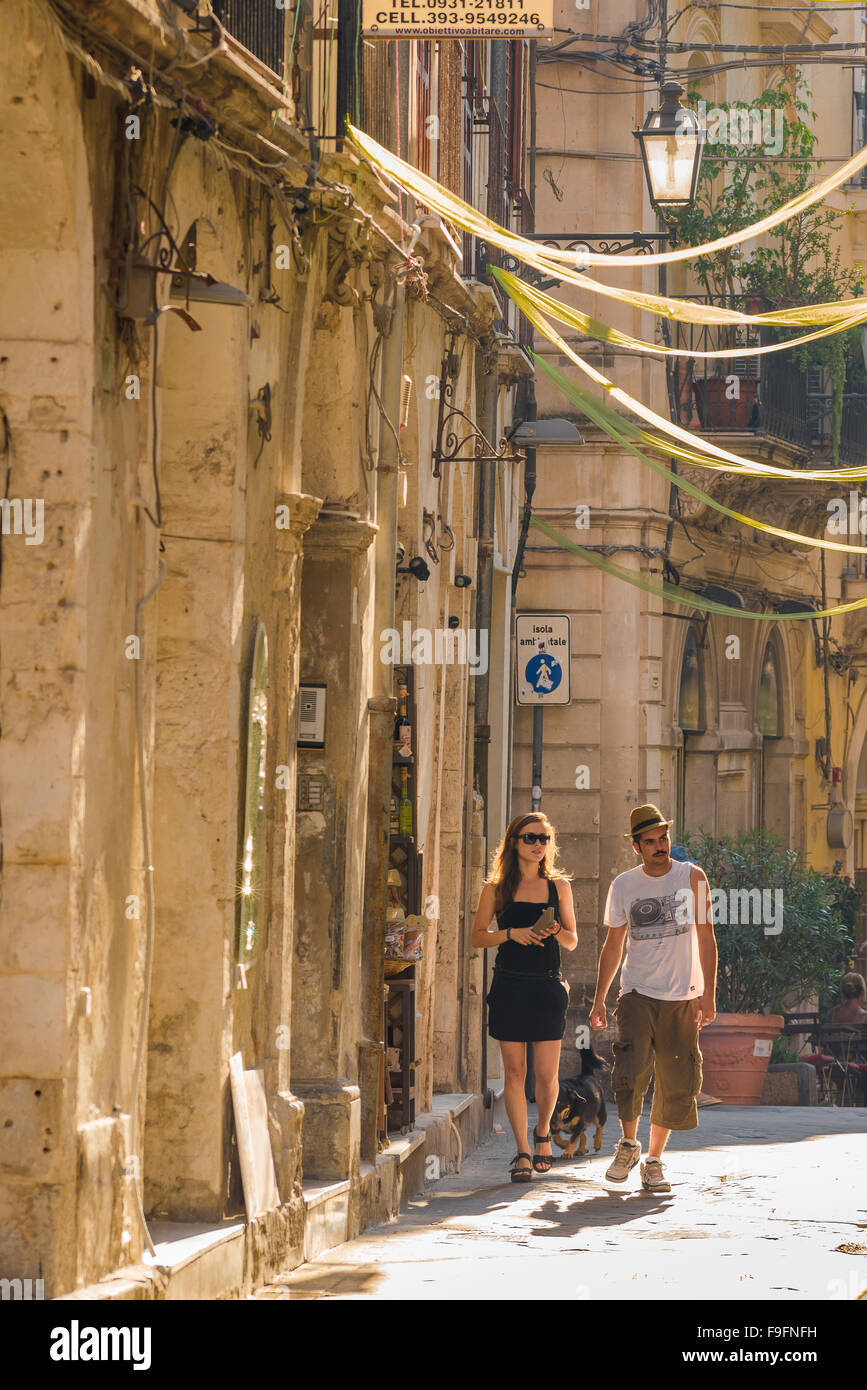 Young couple travel Italy, a young couple take a leisurely stroll through a street in the historic old town quarter Stock Photo