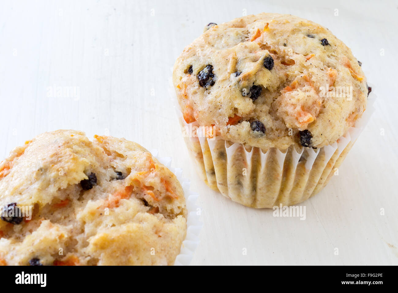 A pair of tasty homemade carrot raisin muffins. - Stock Image