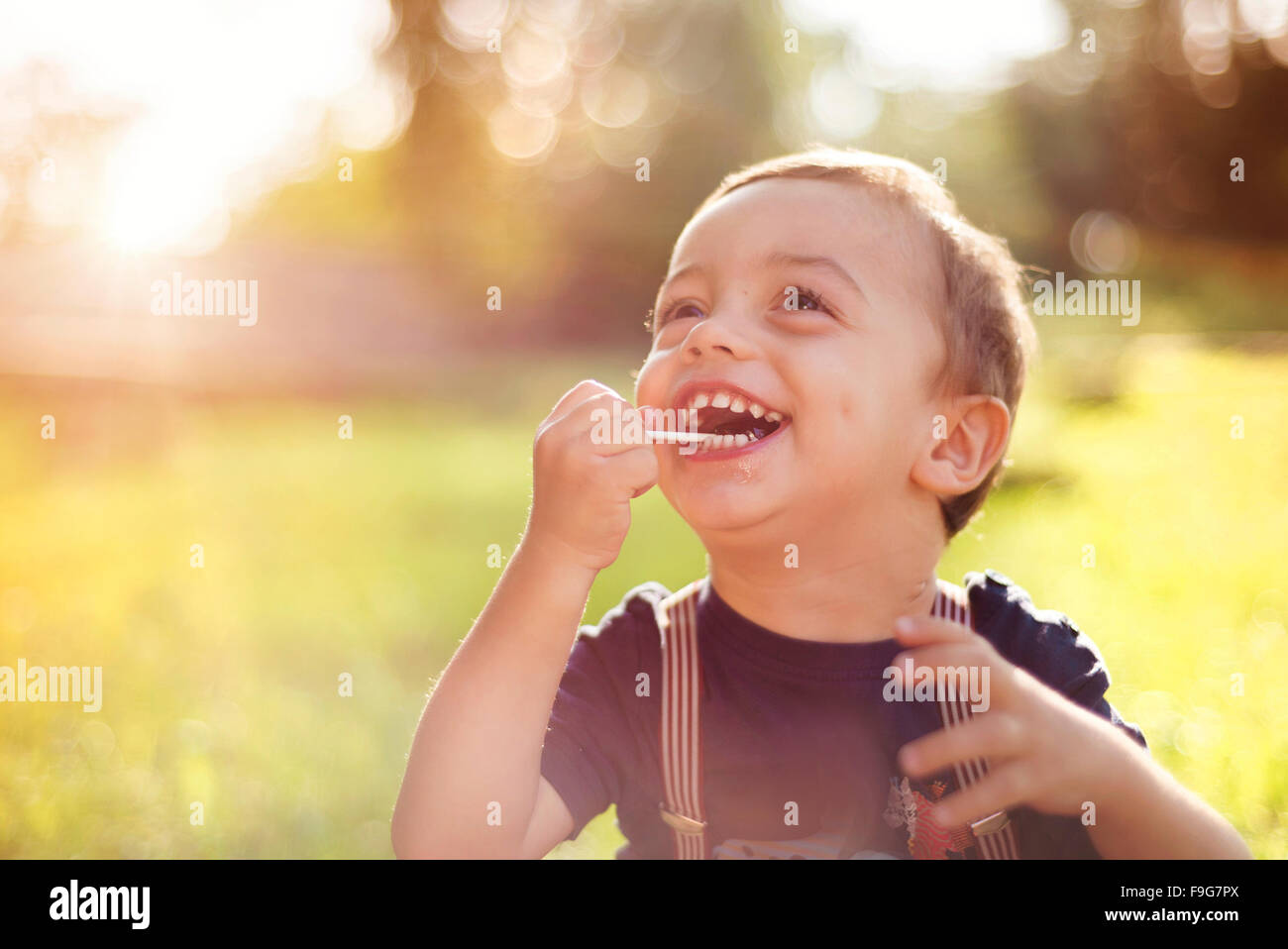 Cute little boy having fun outside in summer nature - Stock Image