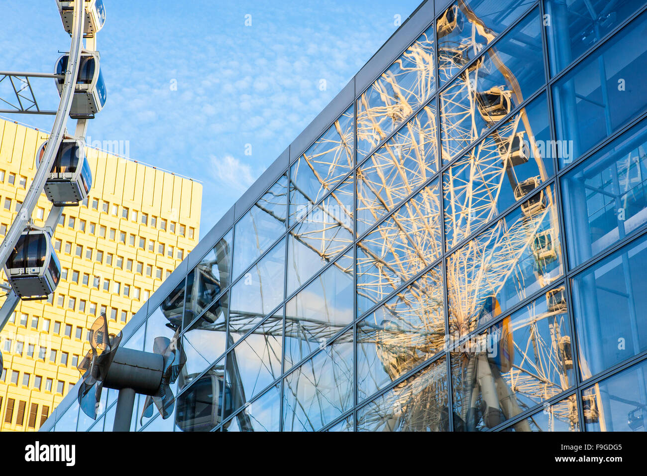 The Wheel of Manchester reflected in Selfridge's department store in Exchange Square, Manchester, England, UK - Stock Image