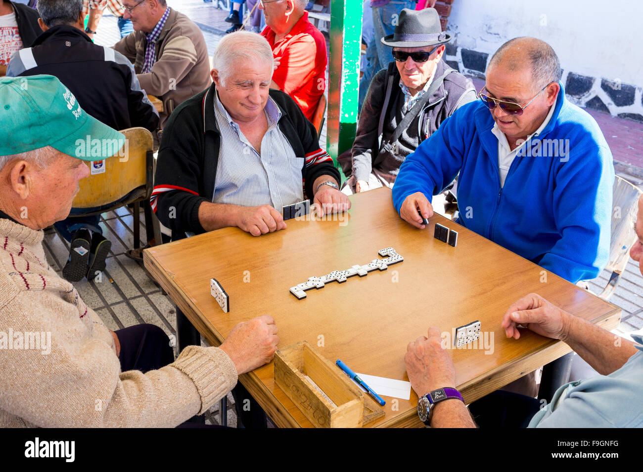 Men playing dominoes, Arrecife, Lanzarote, Canary Islands, Spain - Stock Image