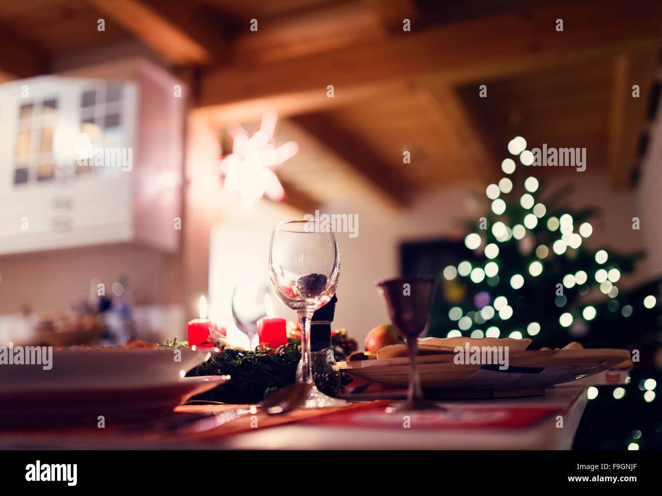 Christmas meal laid on a table in a decorated living room - Stock Image