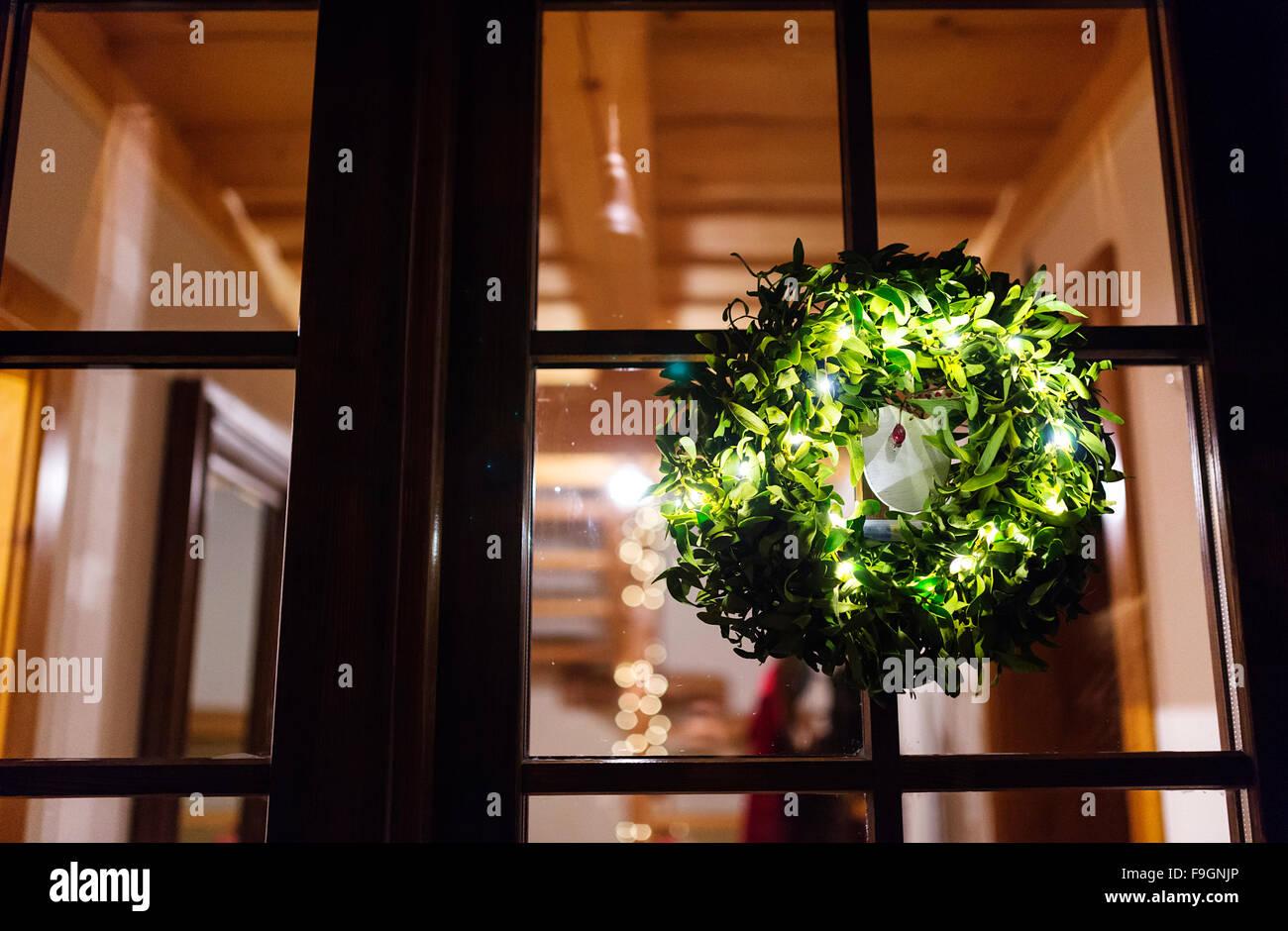Green Mistletoe Wreath Hang On Glass Door