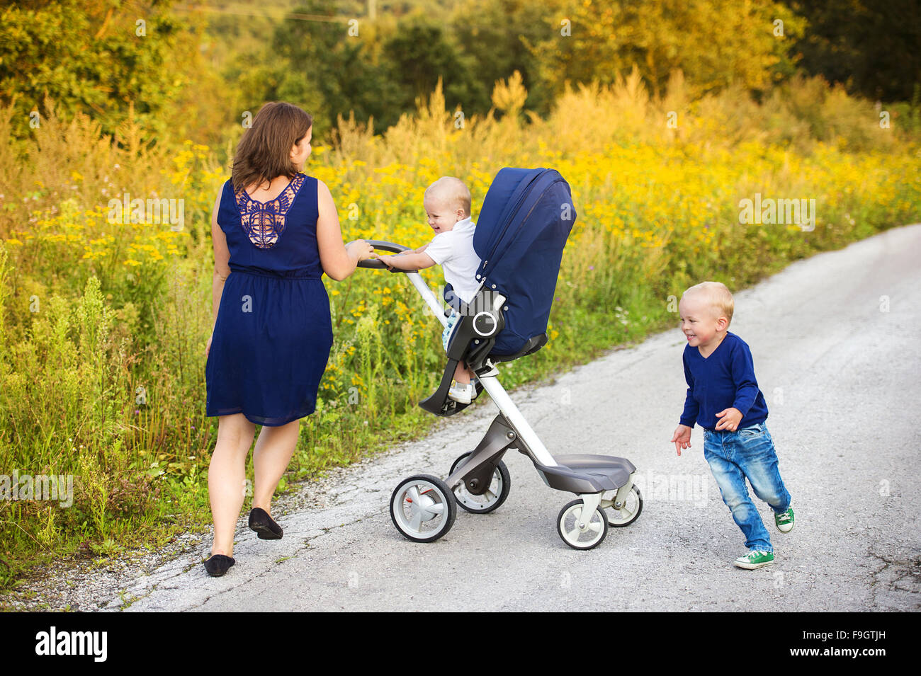 Mother and sons on a walk in nature enjoying life together. - Stock Image