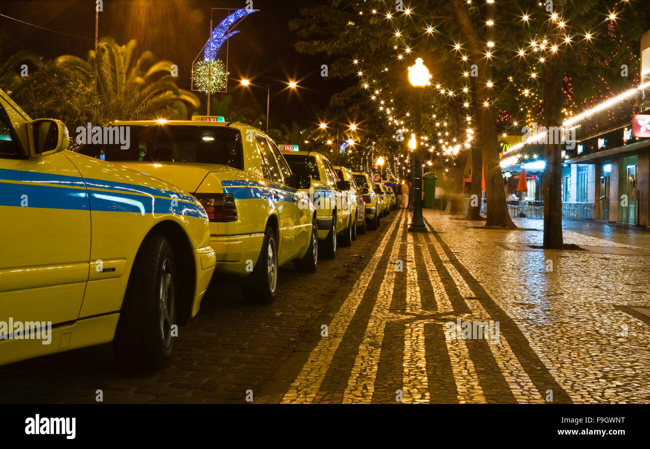 Yellow Taxi Cabs Waiting at night in Funchal Madeira Island, Portugal - Stock Image