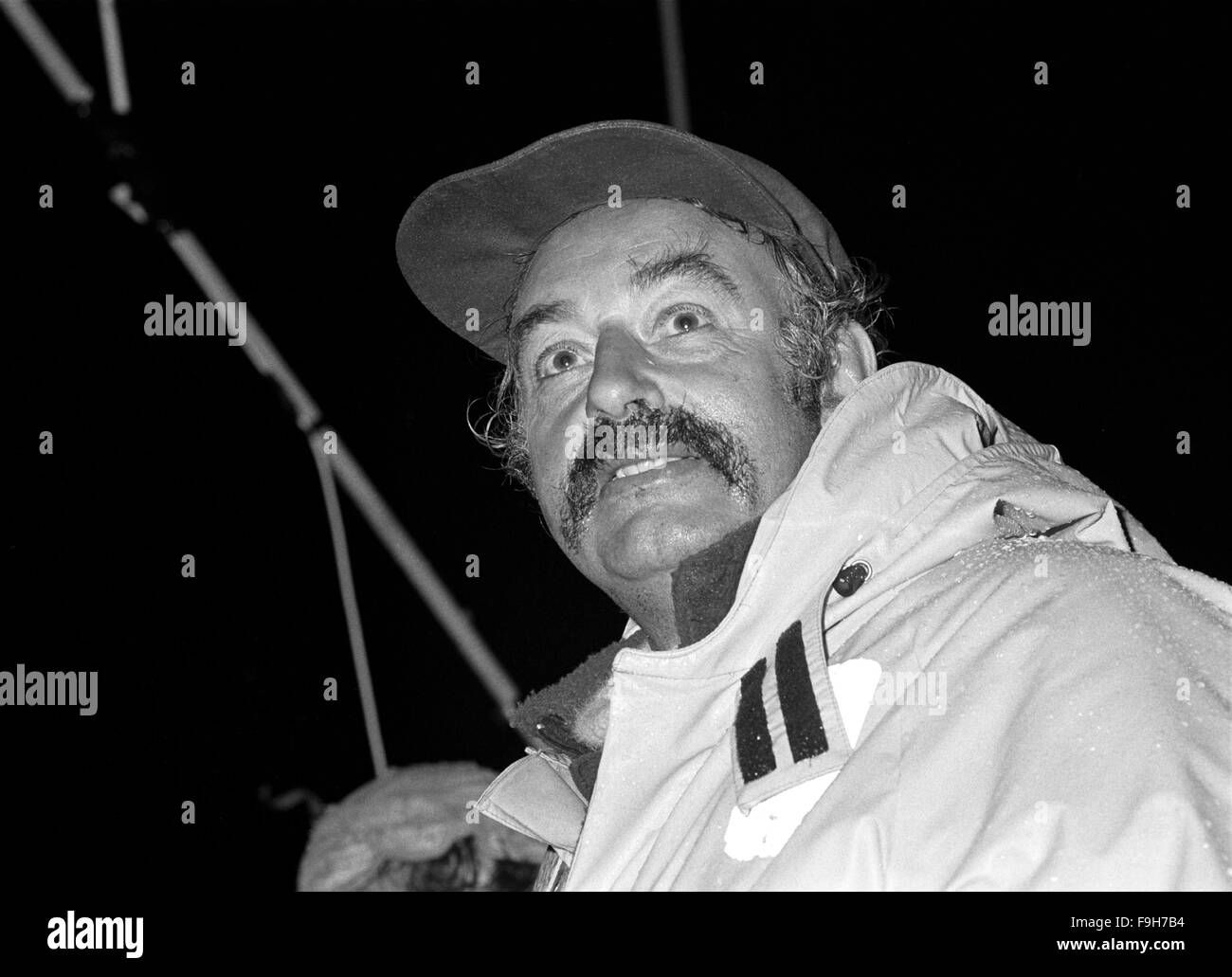 AJAXNETPHOTO. 7TH APRIL, 1982. GOSPORT, ENGLAND - YACHT SKIPPER HOME - RAIN SOAKED AND TIRED FIRST CO-OPERATIVE - Stock Image