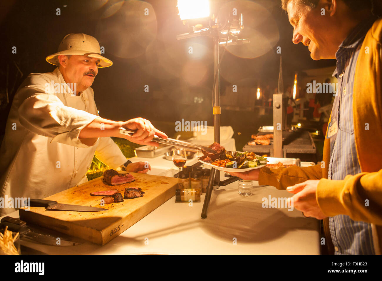Chef Pascal Gode serves meat at the BBQ Bootcamp, Alisal Guest Ranch, Solvang, California - Stock Image