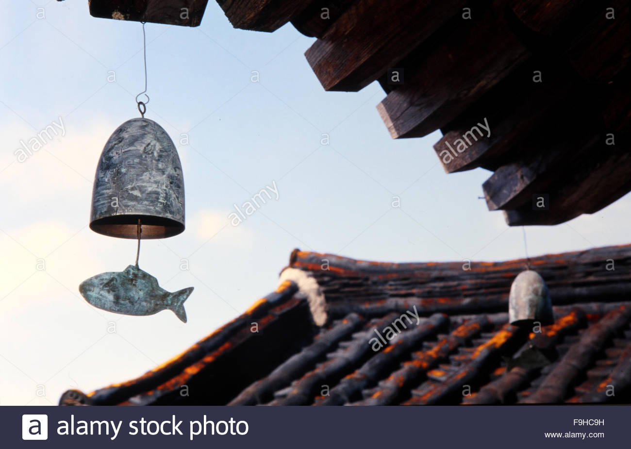 wind chime hanging under the eaves - Stock Image