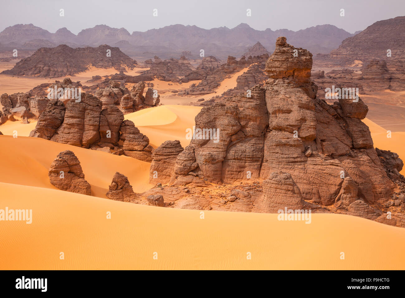 Sandstone and dunes, Jebel Acacus, LIbya, Mountains in Sahara Desert UNESCO World Heritage Site, The Awiss - Stock Image