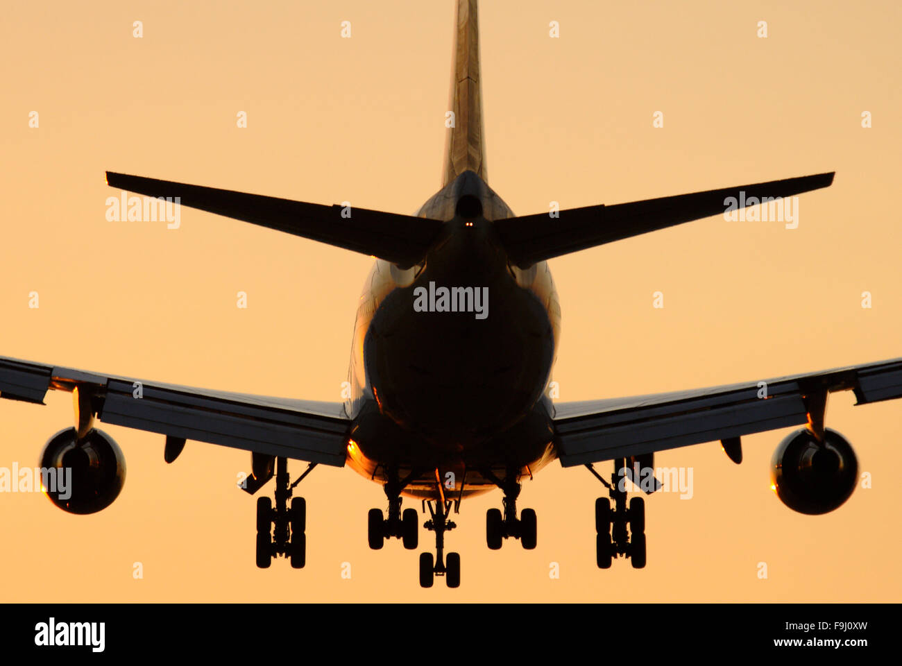 Silhouette of a Boeing 747-400 with Undercarriage During Landing - Stock Image