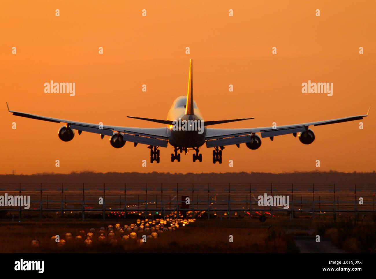 Lufthansa Boeing 747-400 Landing in Early Morning Light - Stock Image