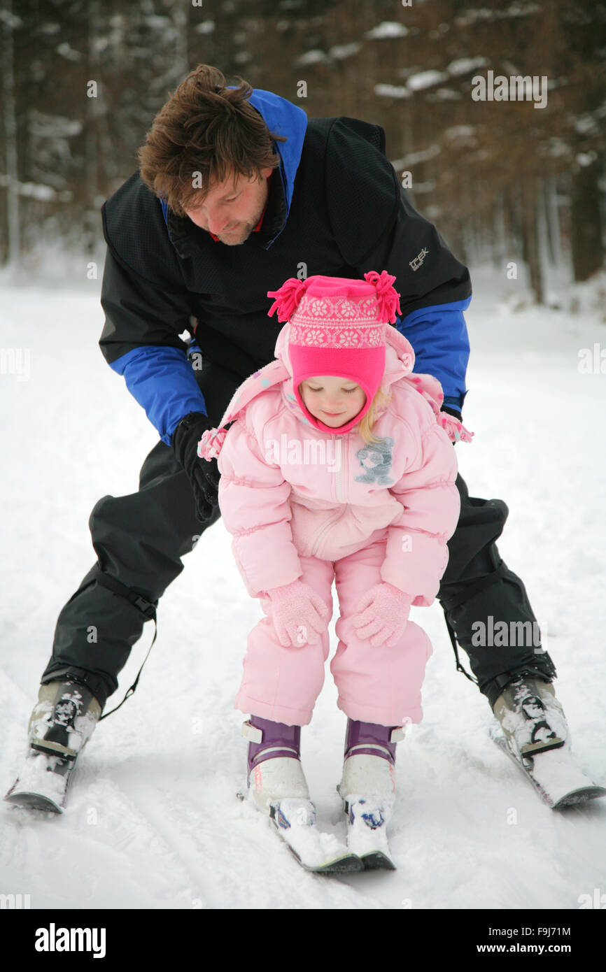 Instructor teaching a child skiing. Winter sport. Winter holiday. Stock Photo