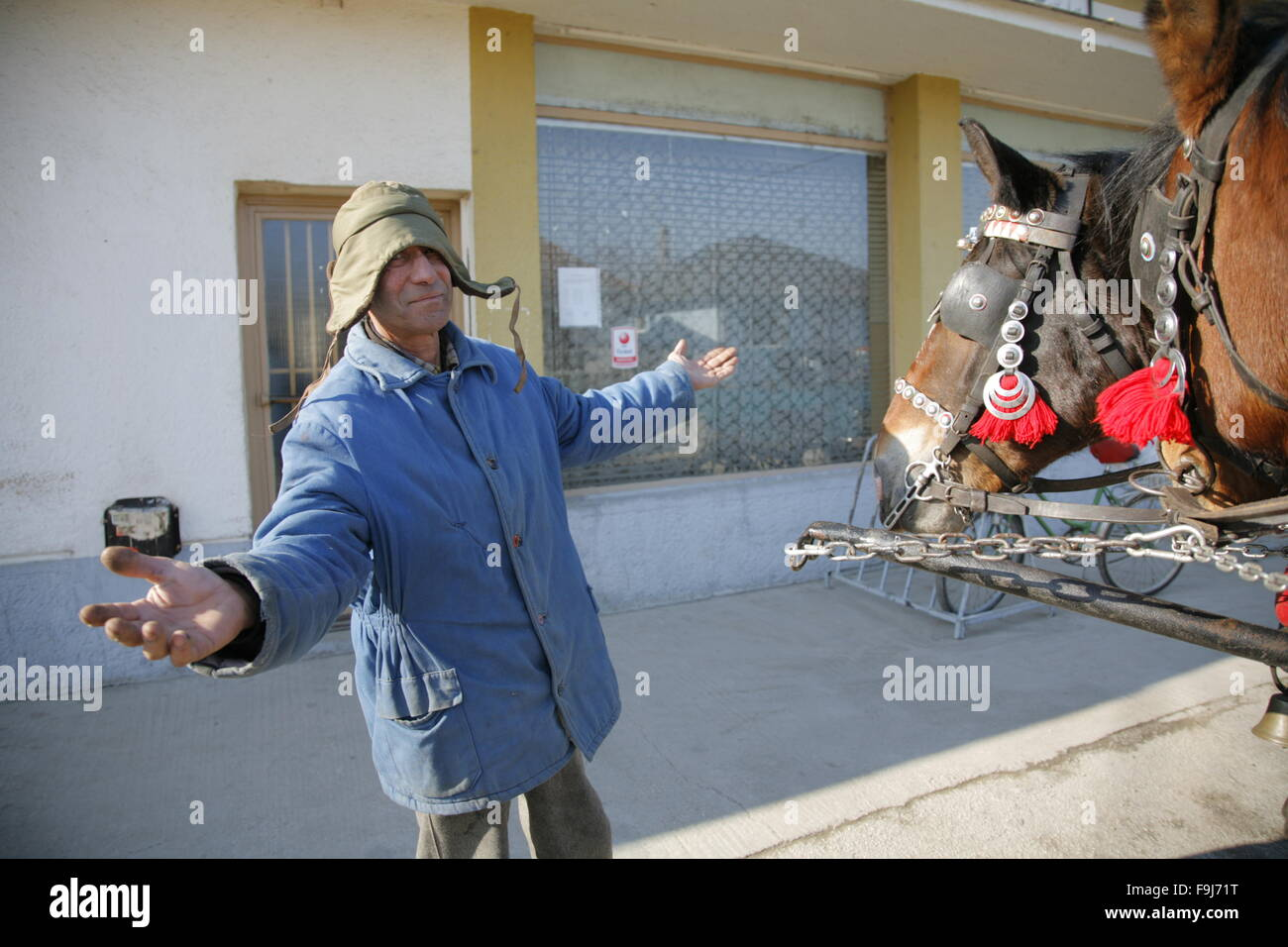 Gipsy man in front of village inn. Slovakia. Social problems, alcohol adicted, poverty, alcoholism. - Stock Image
