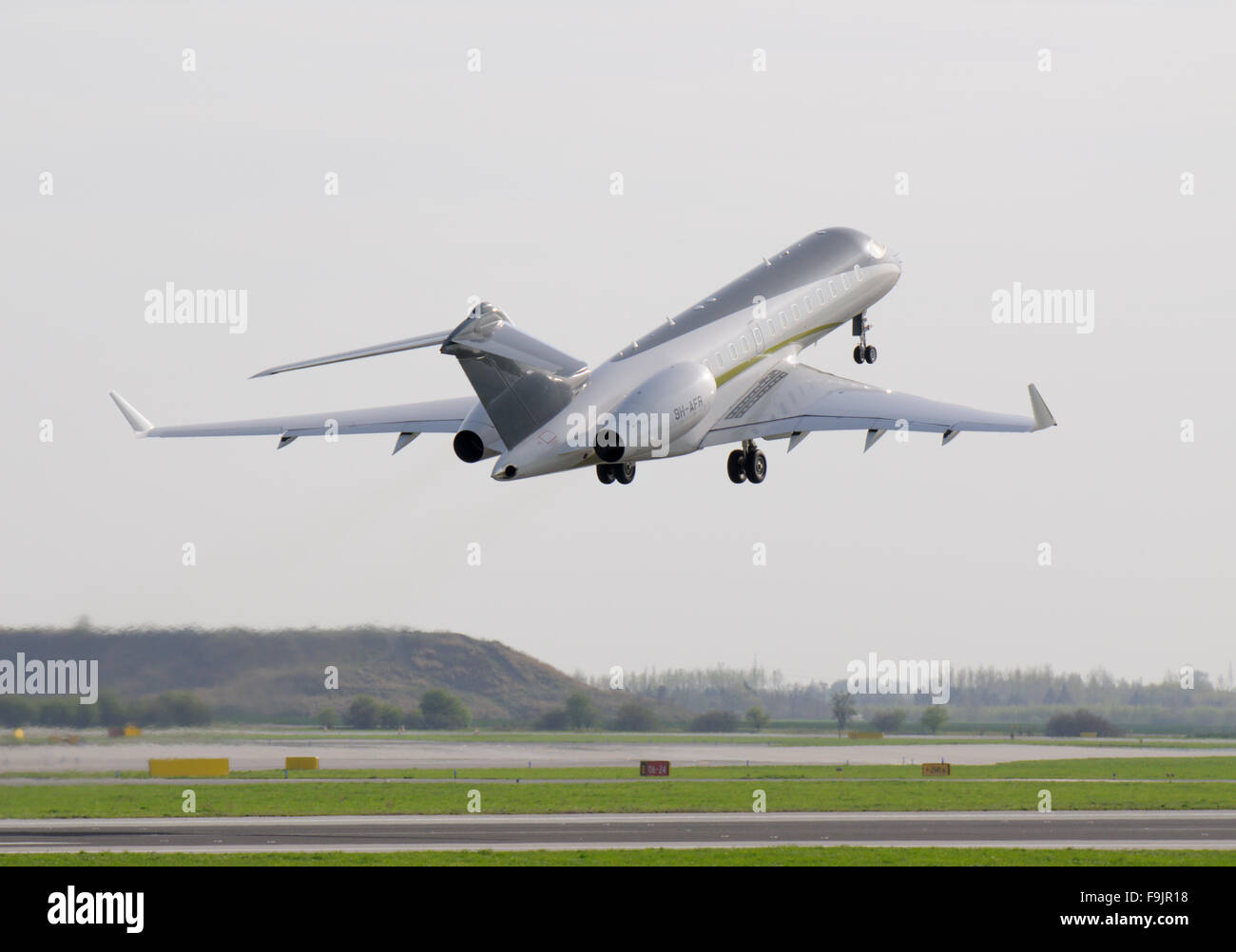 Bombardier BD700 jet taking off (Prague Airport) Stock Photo