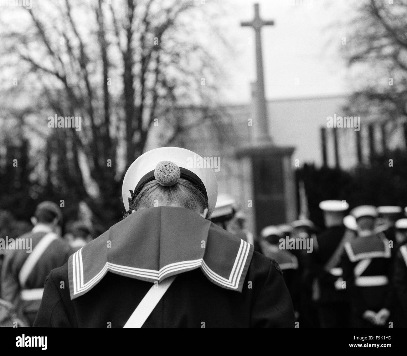 A sea cadet bows her head during the minutes silence at 5the Remembrance Sunday Service in Ashford, Kent. - Stock Image