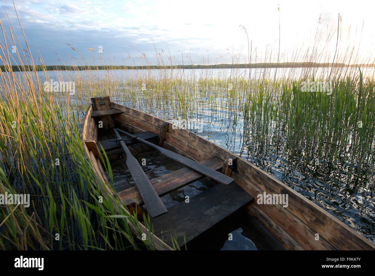 wooden rowboat, drawsko lake (jezioro drawsko), pomeranian lakeland (pojezierze pomorskie), west pomerania, poland - Stock Image