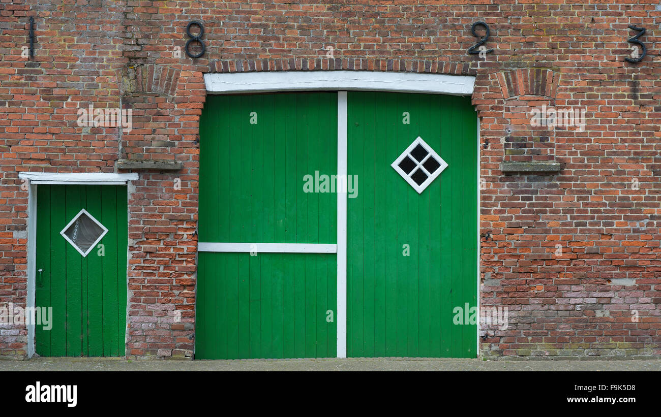 green farm doors, ramsloh, saterland, cloppenburg district, lower saxony, germany - Stock Image