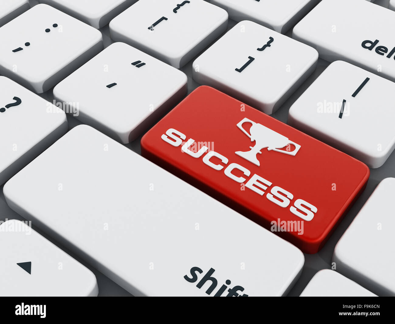 Red success key on computer keyboard - Stock Image