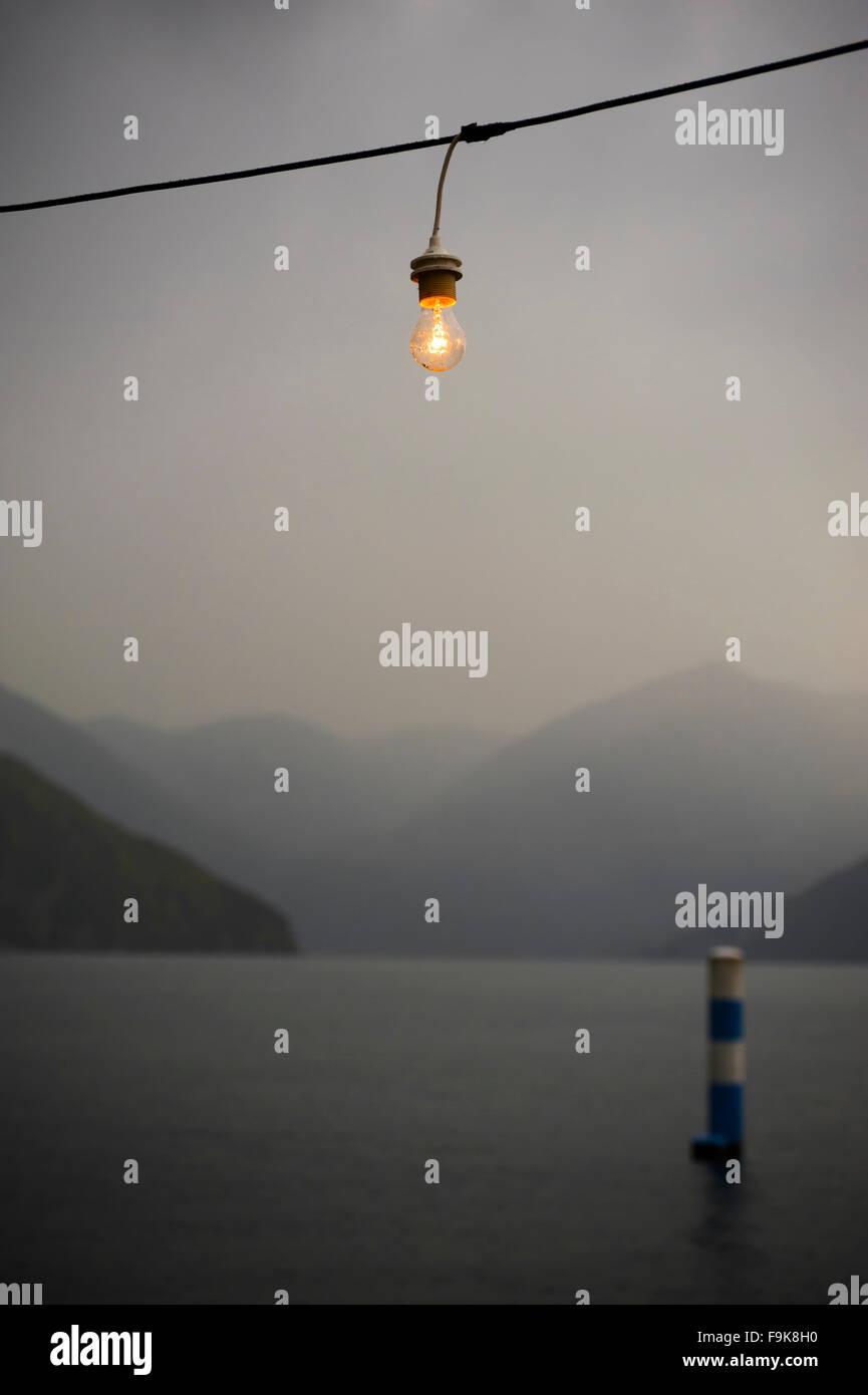 Twilight on Iseo lake with mixed light - Stock Image