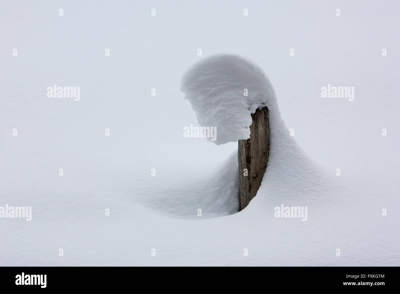 Snow shapes on a fencepost, Switzerland - Stock Image
