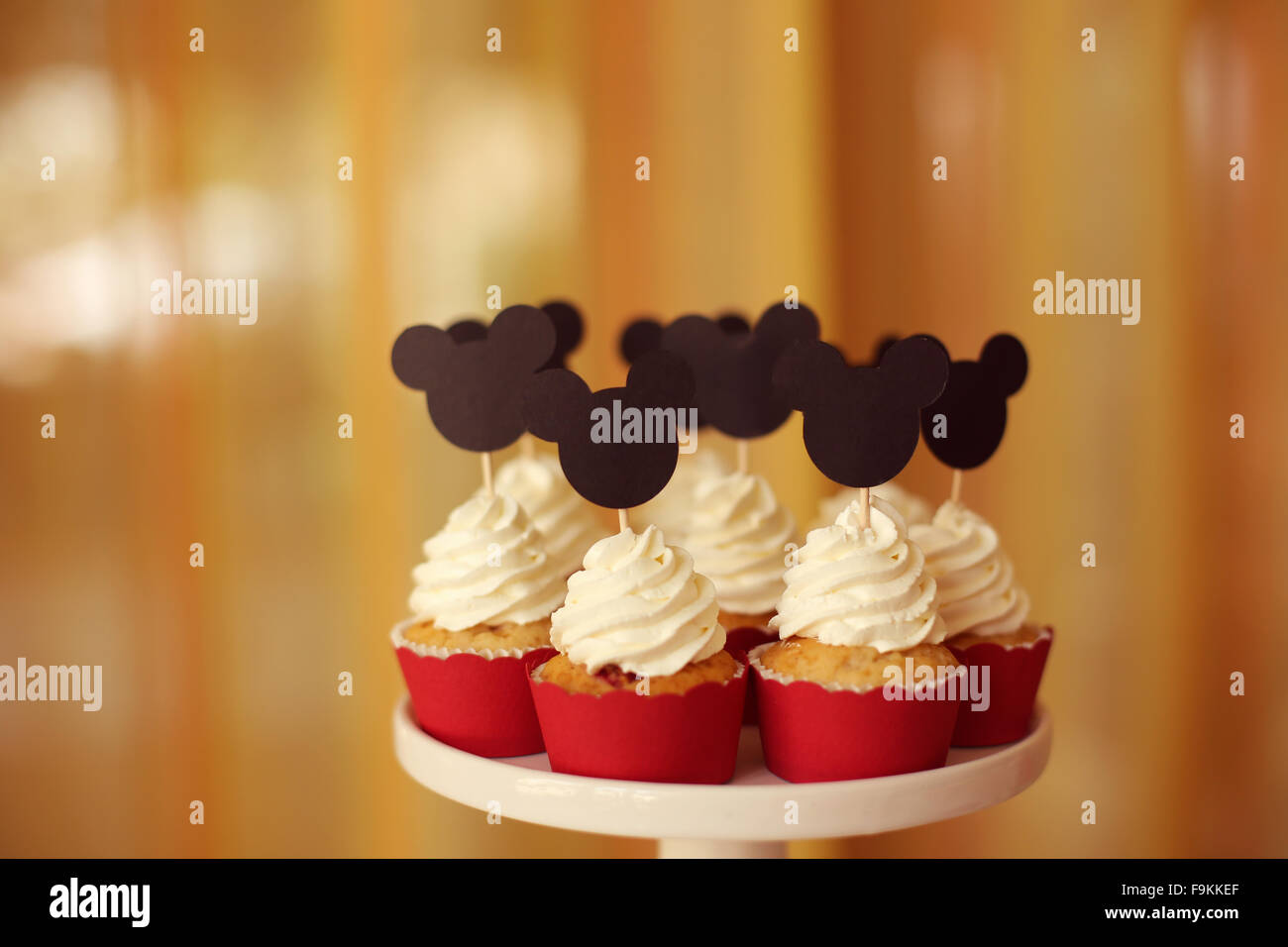 Delicious cupcakes on stand - Stock Image