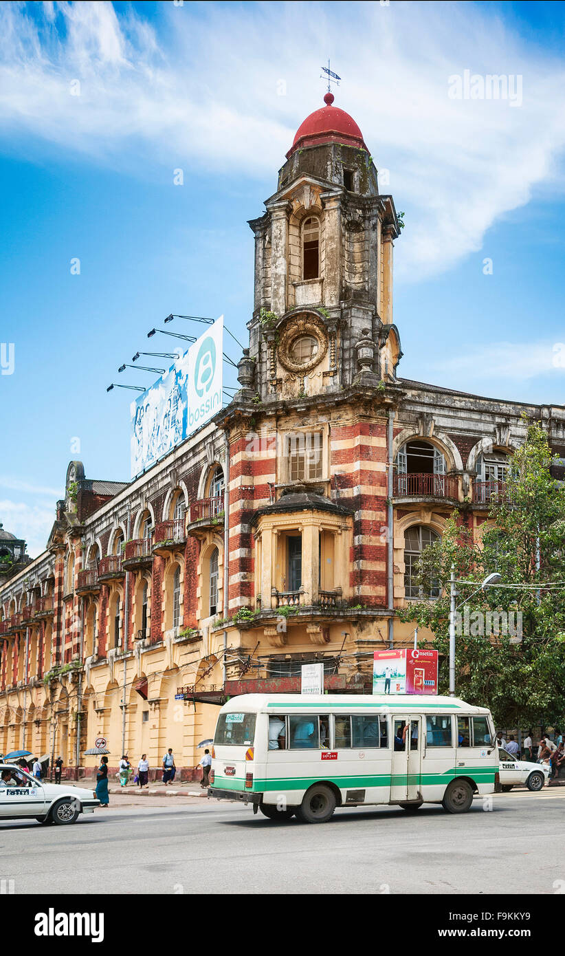 british colonial building and city bus in central yangon myanmar Stock Photo