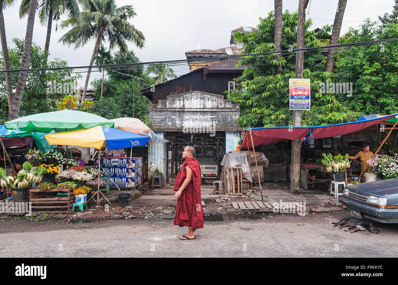 buddhist monk at street market in yangon myanmar - Stock Image