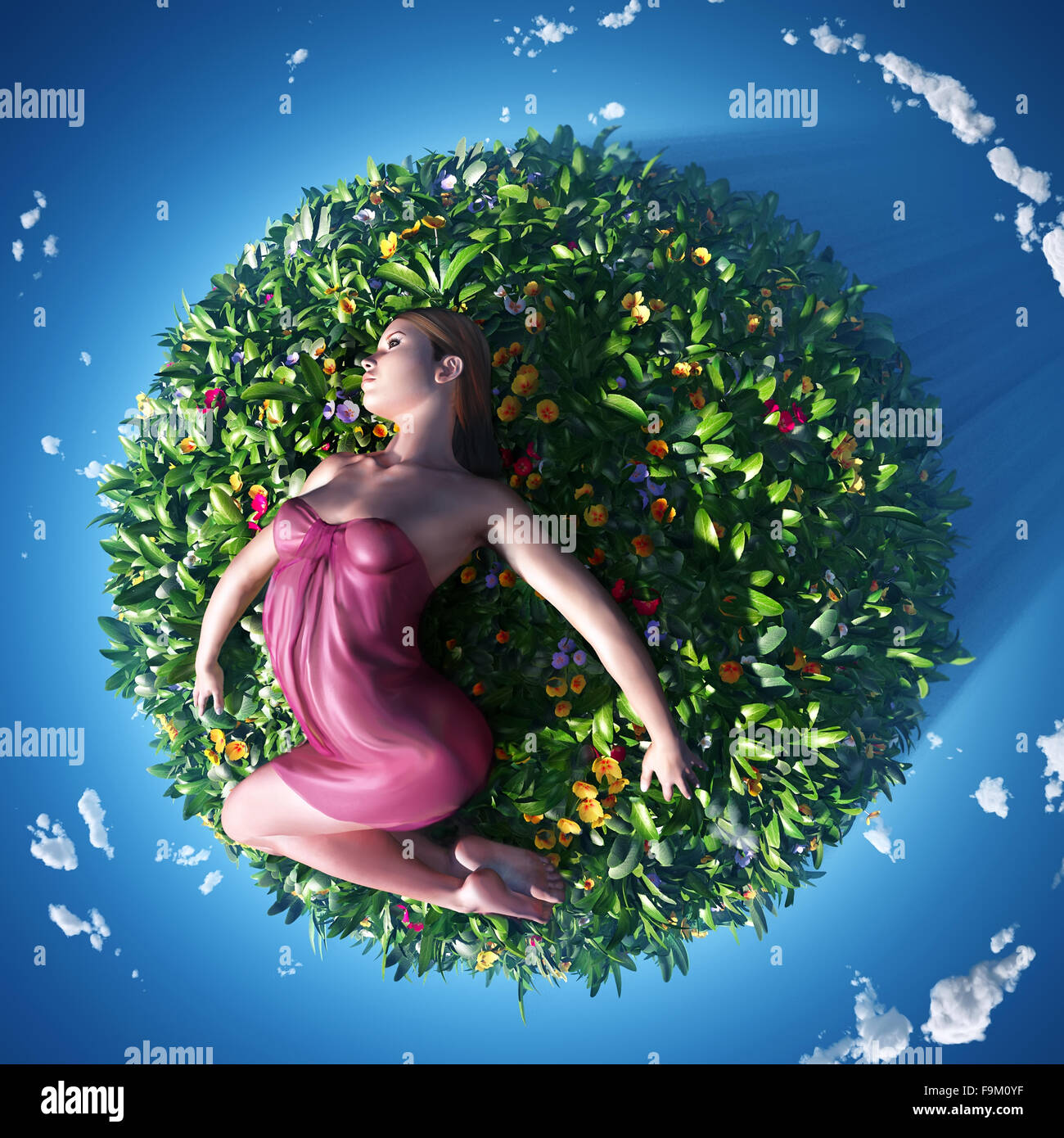 girl lying on the small planet - Stock Image